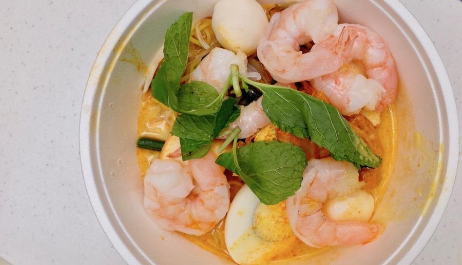 colorful bowl of laksa noodle soup