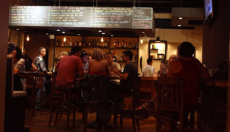 Patrons gather at the bar of the old Pint + Jigger in Moiliili