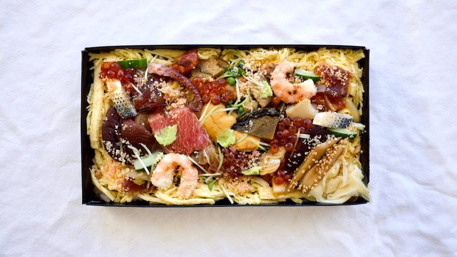 an array of seafood, shiitake and slivered omelet top an exquisite chirashi dish