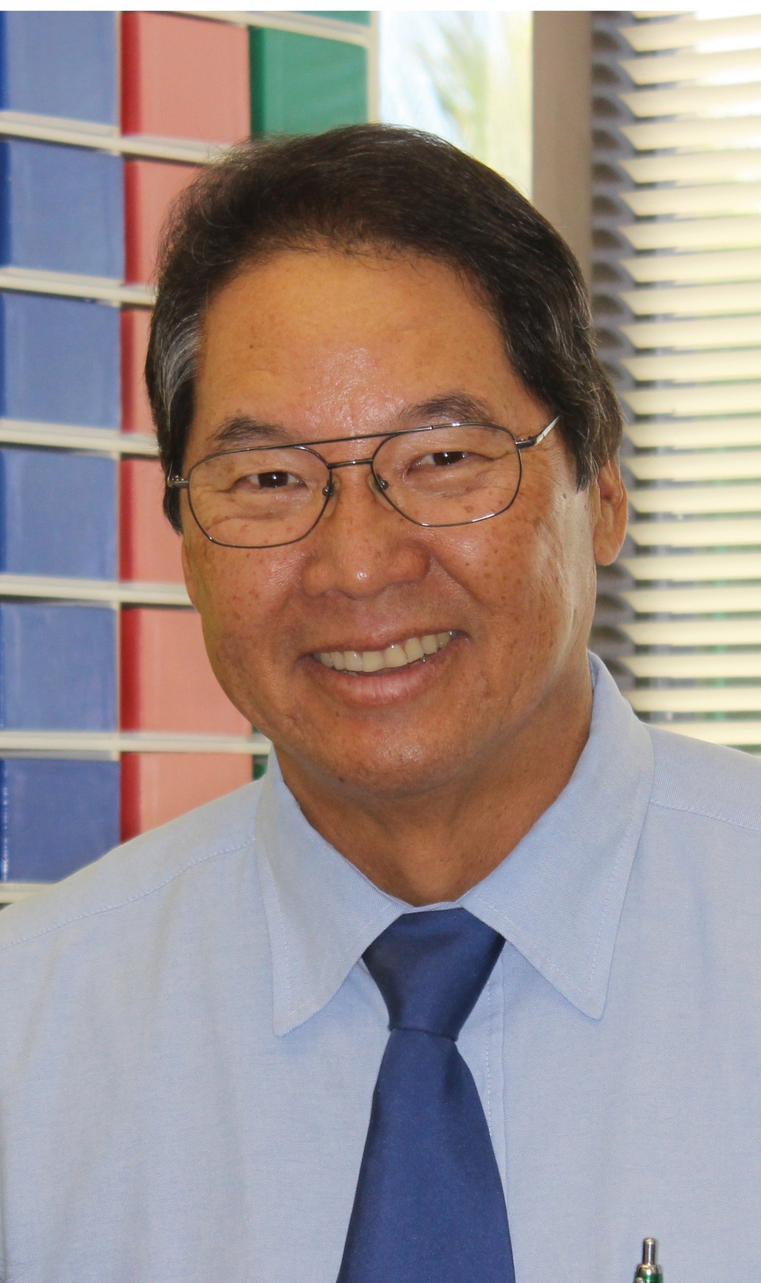 Curtis N. Kamisugi, D.D.S., M.S.D.