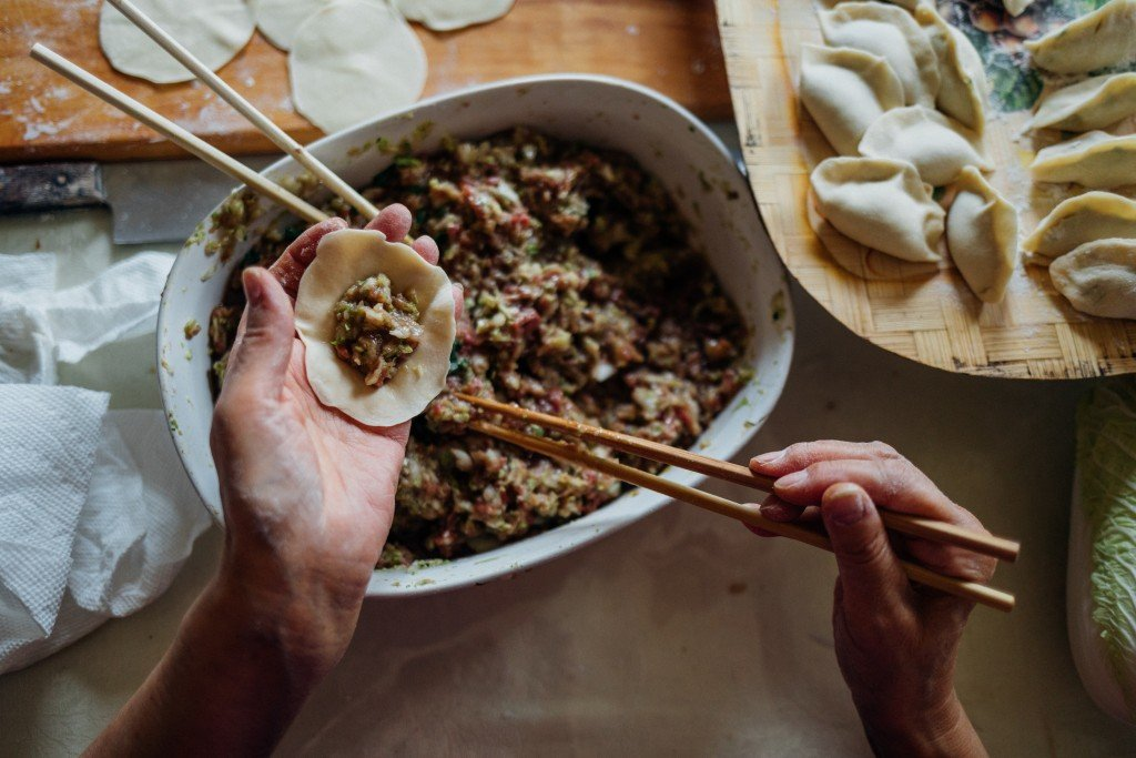 Making dumplings by Frank Zhang via Unsplash