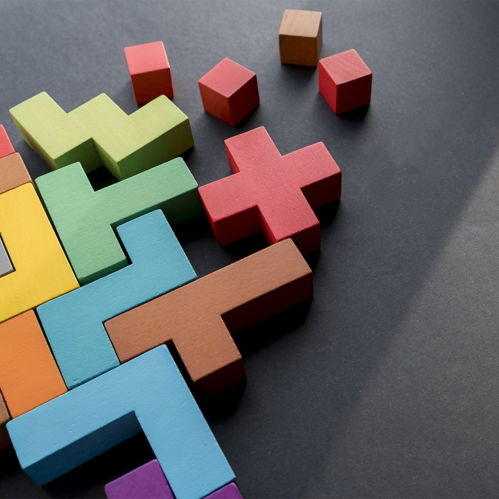 Different Colorful Shapes Wooden Blocks On Black Background, Flat Lay. Geometric Shapes In Different Colors, Top View. Concept Of Creative, Logical Thinking Or Problem Solving. Copy Space
