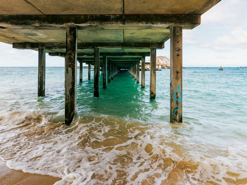 The underside of the Makai Research Pier near Sea Life Park in Waimānalo is perfect for lookbook and lifestyle shots.