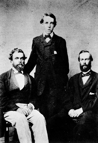 SHIPWRECK SURVIVORS CAPTAIN JOSIAH MITCHELL AND THE TWO FERGUSON BOYS, PHOTOGRAPHED IN HONOLULU, JULY 13, 1866.
