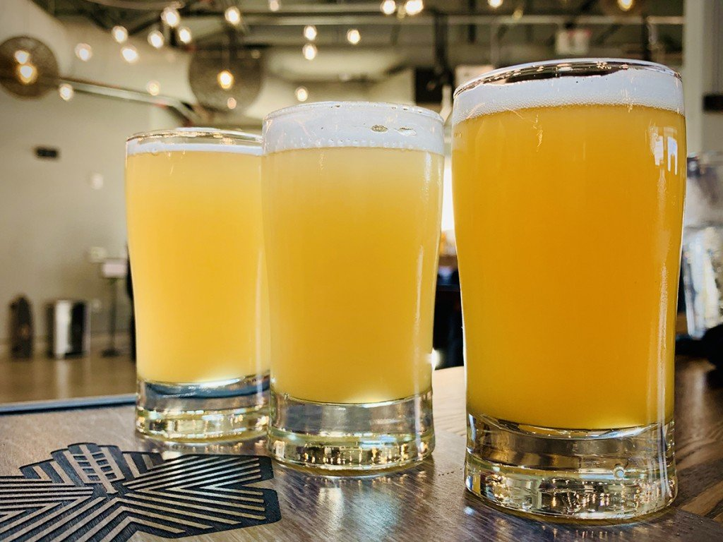 Hana Koa Brewing Co Kakaakos Newest Brewery And Largest Taproom Flight On Hightop Cover