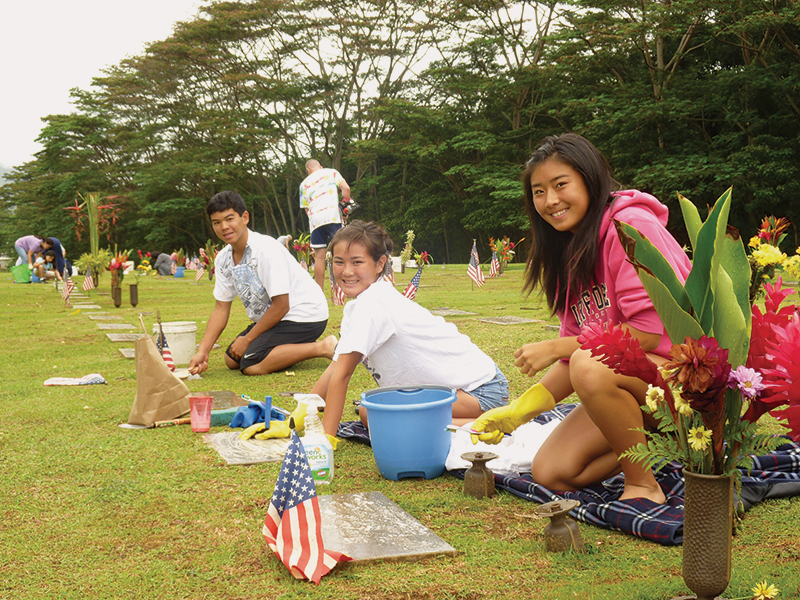 AT THE SUGGESTION OF A STUDENT THERE, 'IOLANI STUDENTS LAUNCHED A PROJECT TO CLEAN GRAVE STONES AT THE HAWAI'I STATE VETERANS CEMETERY.