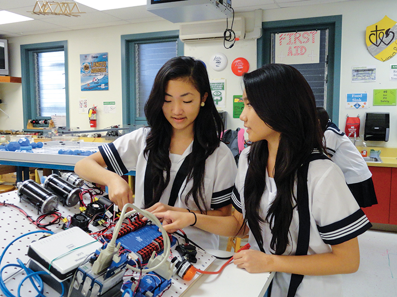 At Sacred Hearts Academy, an all-girls school, the Chock sisters take an interest in robotics, typically a male-dominated subject in coed schools.