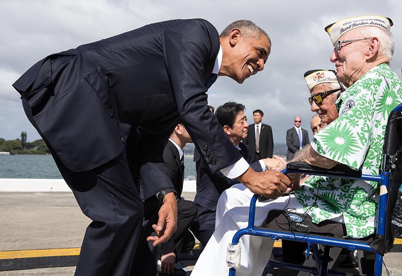 President Barack Obama greeting Pearl Harbor survivors.
