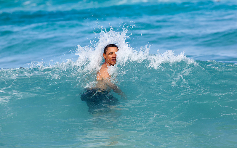 President Barack Obama surfing.