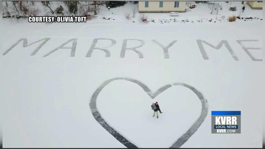 Aviation student proposes with huge  'Marry Me' message on frozen lake