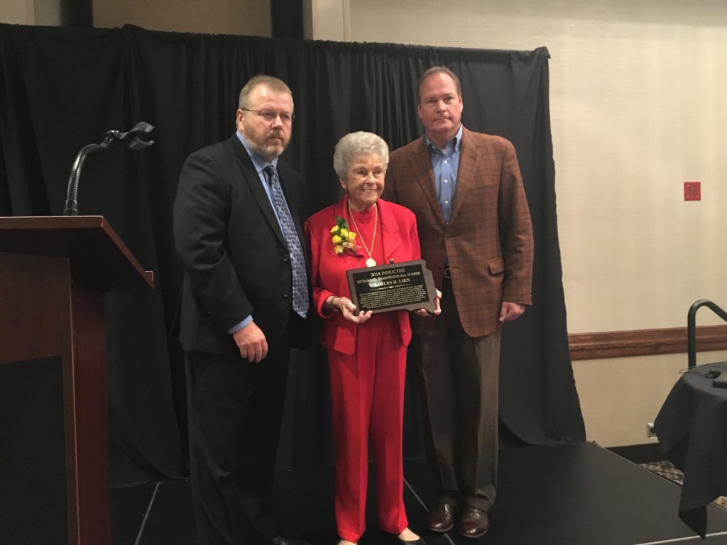 Barbara and Chris Lien receive a plaque from S.D. Transportation Secretary Darin Bergquist. Barbara's husband and Chris' father, the late Chuck Lien, was inducted into the South Dakota Transportation Hall of Honor Thursday. Photo Date: Sep. 27, 2018.