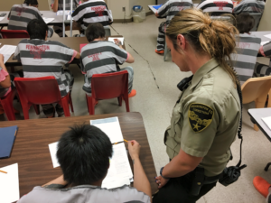 Correctional Officer Tami Rosser helps an inmate with GED studies. The Pennington County Jail brought the program back for the first time since 2005. Photo Date: Sep. 27, 2018.