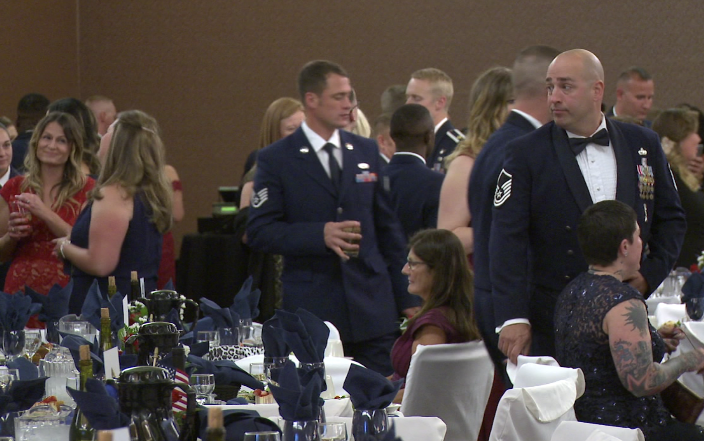 Airmen and women mingle and share stories during the Ellsworth Air Force Ball on Saturday, Sept 23, 2018.