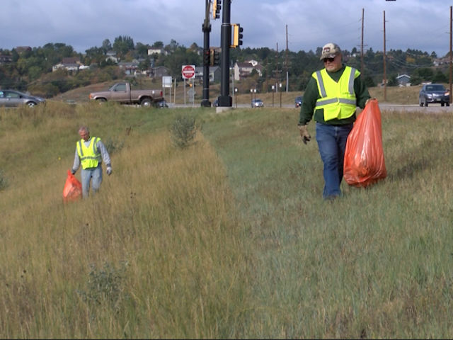 Members of the Pennington County Democratic Party pick up trash along the Highway 16 By-pass south of Rapid City Saturday morning. They don't just want to keep the city clean, but also draw attention to litter control legislation. Photo Date: Sep. 29, 2018.