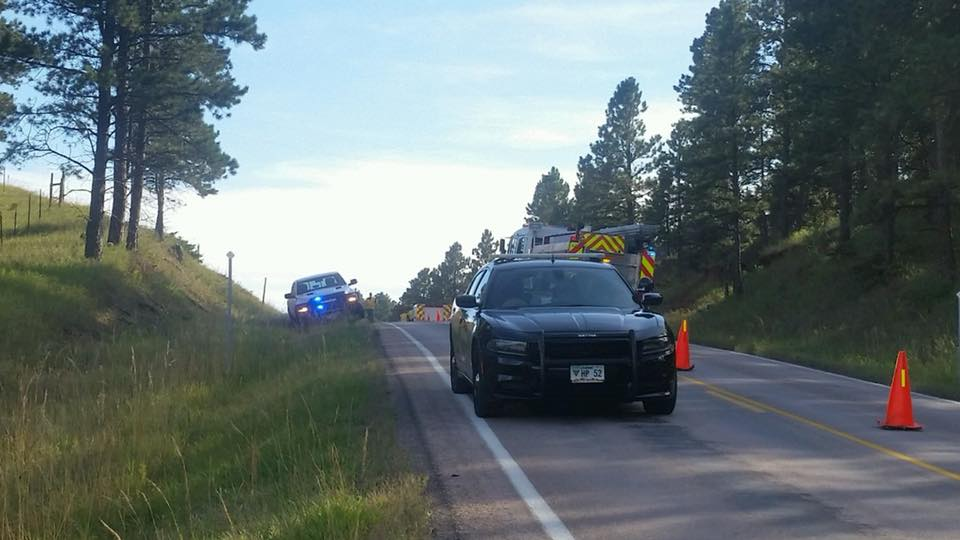 In this Sept. 22, 2018 photo, law enforcement stands by along Neck Yoke Road near Highway 16 where a van rolled over, causing injuries.