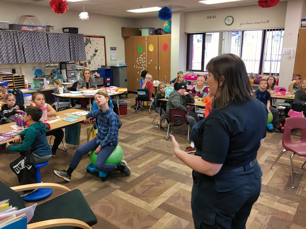 Monica Colby gives a presentation to third-graders at Corral Drive Elementary School about fire safety, and how quickly fire can spread in a home. Photo Date: Oct. 10, 2018.