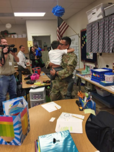 Master Sgt. Day embraces his son, Ethan, at school. Day returned from a 6-month deployment in Iraq Wednesday and wanted to surprise Ethan. Photo Date: Oct. 10, 2018.