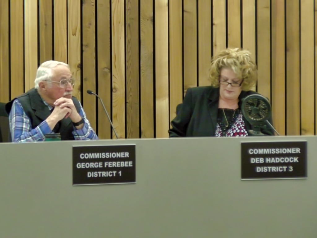 Commissioners George Ferebee and Deb Hadcock in a meeting of the Pennington County Commission. Ferebee is being urged to resign his seat after allegedly moving out of his district and failing to attend numerous meetings of the Commission. Photo Date: May 15, 2018.