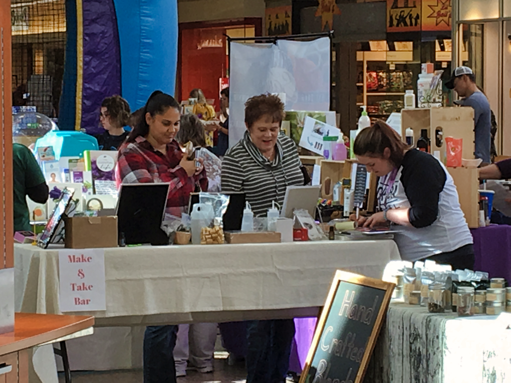 Visitors to the Fall Harvest Vendor Fair at the Rushmore Mall look at a vendor's wares Saturday. Photo Date: Oct. 6, 2018.