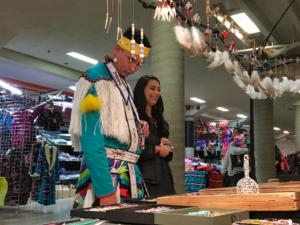Participants in the Black Hills Powwow peruse the wares of a vendor at the powwow. Preliminary numbers are showing this year's powwow had higher attendance than last year's.