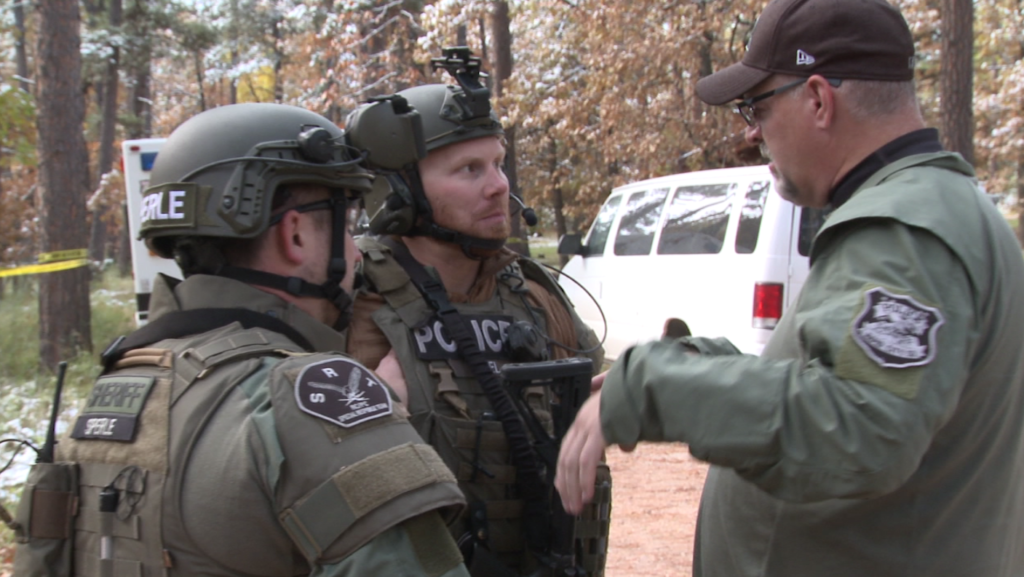 Two members of the SRT receive a briefing from Captain James Johns of the RCPD on Oct. 11, 2018.