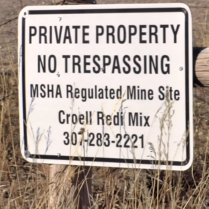 A sign on the boundary of Croell, Inc. property near Highway 16 in Pennington County.