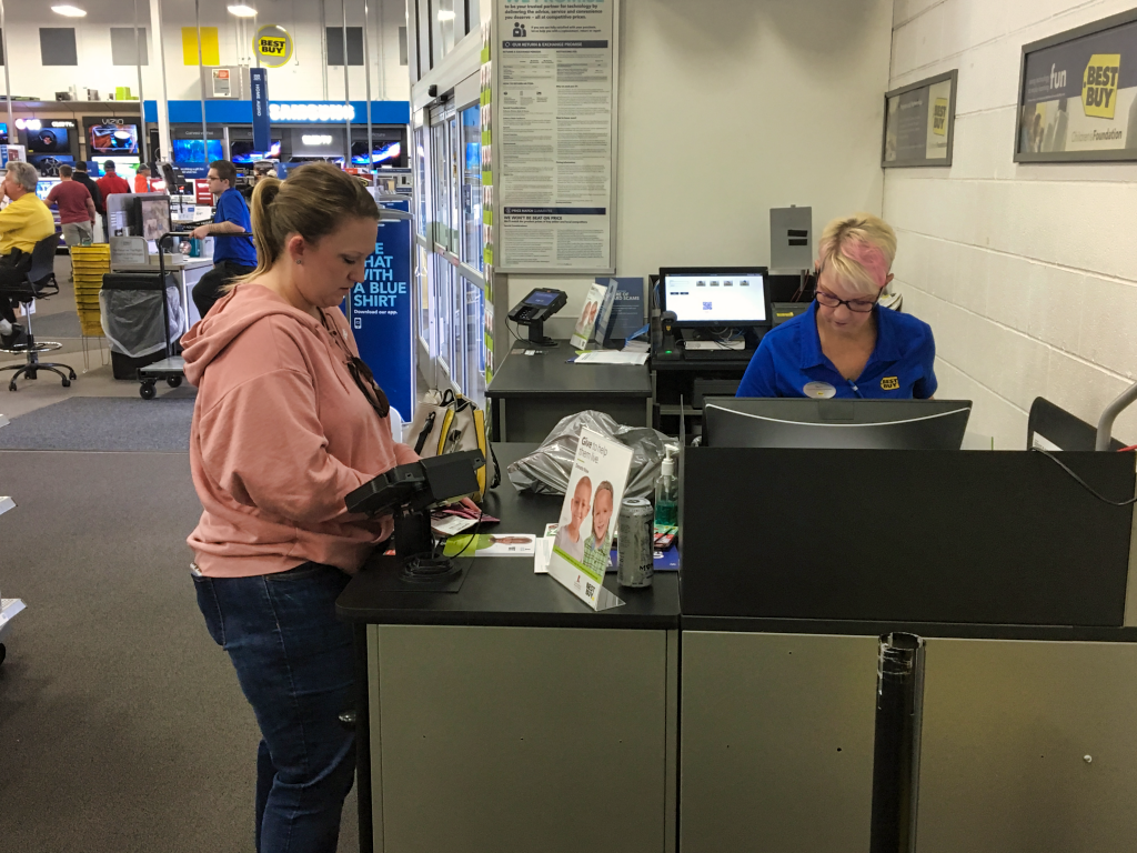A shopper in the Rapid City Best Buy completes her purchase on Black Friday 2018. Photo Date: Nov. 23, 2018.