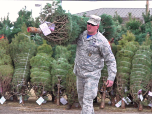 Master Sergeant Bricker carries a fresh Christmas tree to a waiting family at Ellsworth Air Force Base Friday. Photo Date: Nov. 30, 2018.
