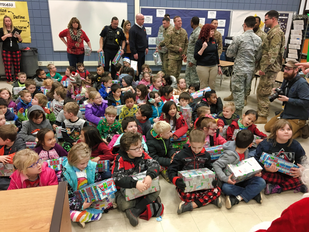 First graders receive gifts from Santa Claus and Westjet Air Services Wednesday. Photo Date: Dec. 19, 2018.