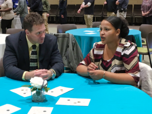 A participant in the Akicita Mentorship talks with her mentor during a luncheon at Western Dakota Technical Institute Thursday. Photo Date: Dec. 6, 2018.