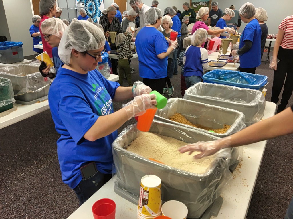 A volunteer helps pack a meal for Kids Against Hunger Saturday morning at the South Canyon Lutheran Church in Rapid City. Photo Date: Dec. 8, 2018.