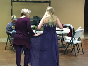 A young lady who is planning on attending Rapid City's second Night to Shine, tries on a dress at Bethel Church Sunday afternoon. Photo Date: Jan. 13, 2019.