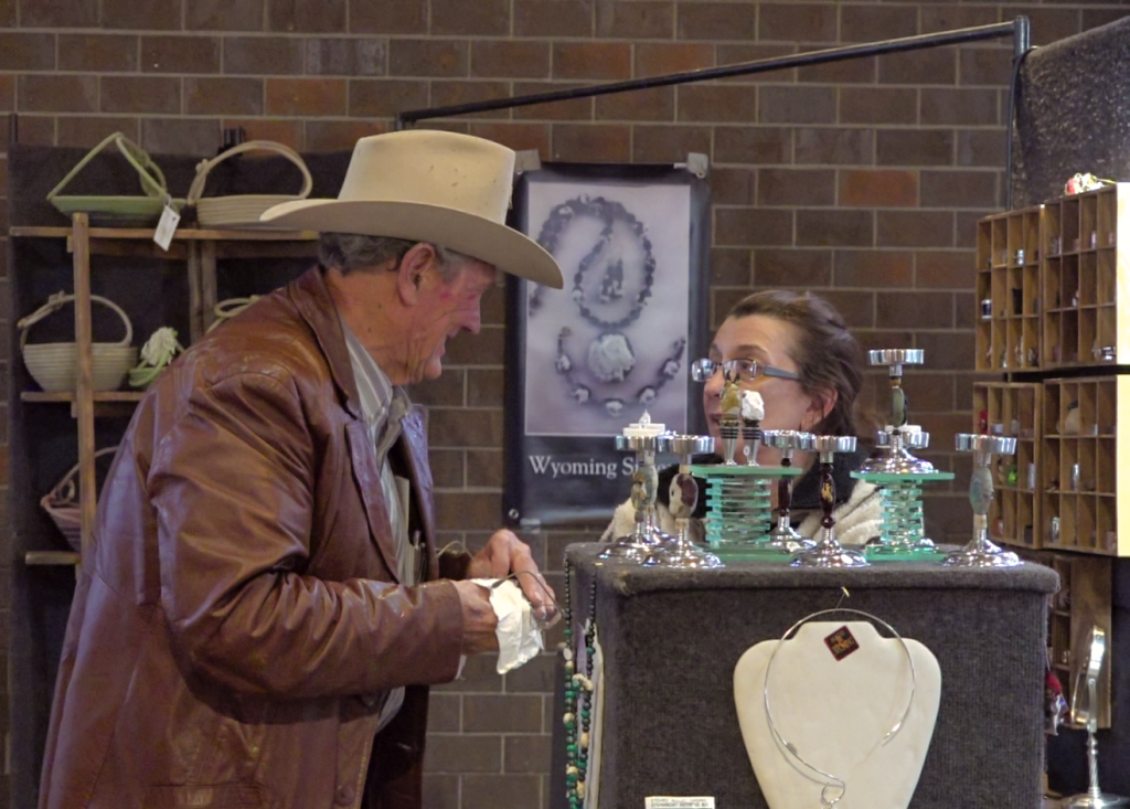 A visitor to the BankWest Western Art Show discusses art with a vendor at the Black Hills Stock Show and Rodeo Sunday afternoon. Photo Date: Jan. 27, 2019.