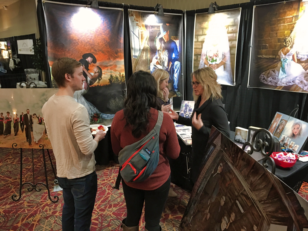 Visitors to the Bridal Showcase talk with a vendor at the Ramkota Hotel Saturday afternoon. Photo Date: Jan. 5, 2019.