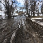 A flooded road in Pine Ridge area after 2019 flooding