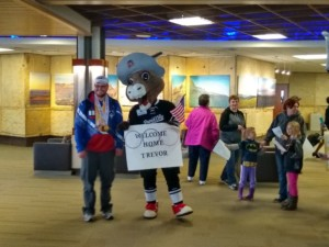 Trevor Tridle welcomed home by Rapid City Rush mascot Nugget