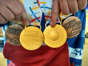 Trevor Tridle displays his four medals from the Special Olympics World Championship