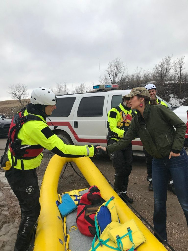 Gov. Noem meets with water rescue team after they helped a family in Oglala Lakota County get to safety.