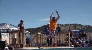 A man jumps into freezing cold water in the 2019 Polar Plunge