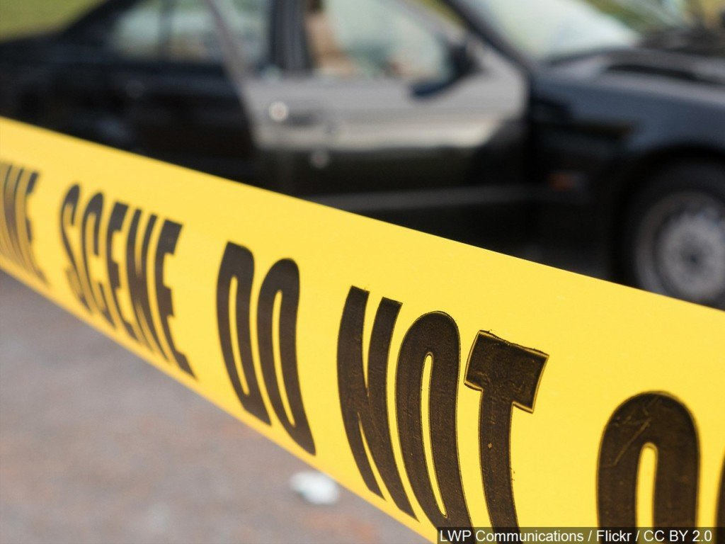 Yellow police tape across a crime scene