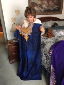 Ruth showing clothes acquired from missionary travels