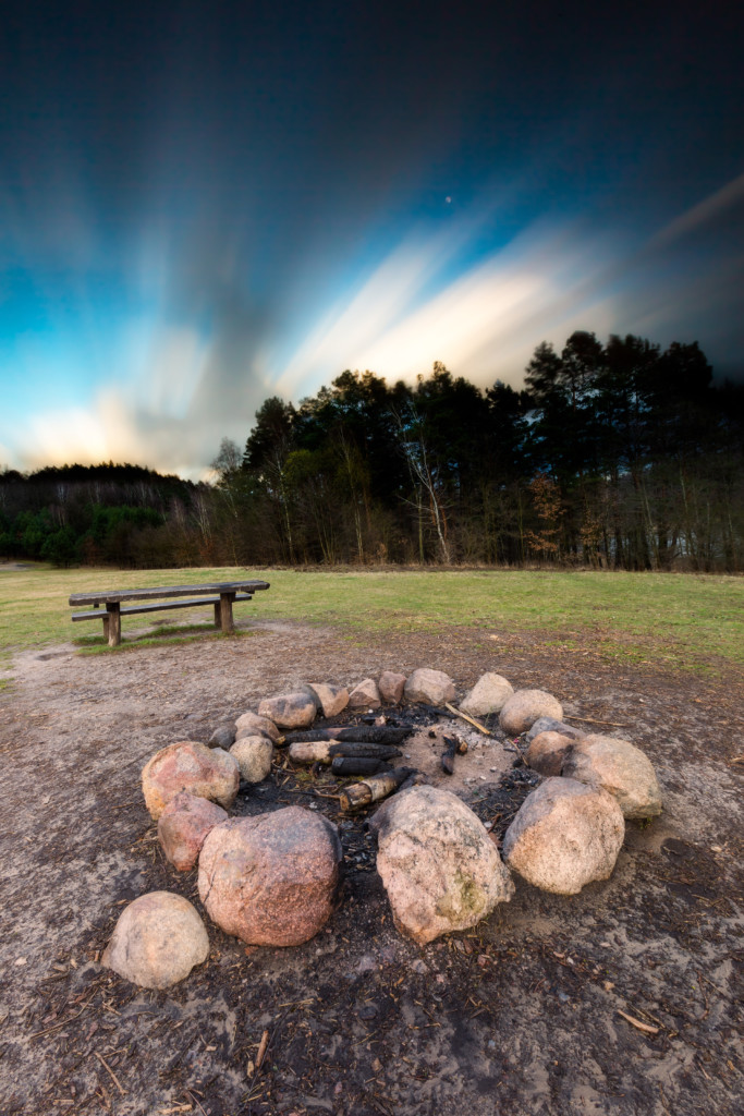 Landscape with campfire place. Long exposure photo.