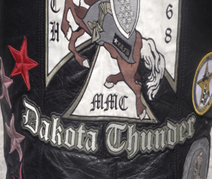 The Green Knights military motorcycle club's colors (the bottom of the best that says Dakota Thunder)