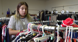 North Middle School Student hanging clothes