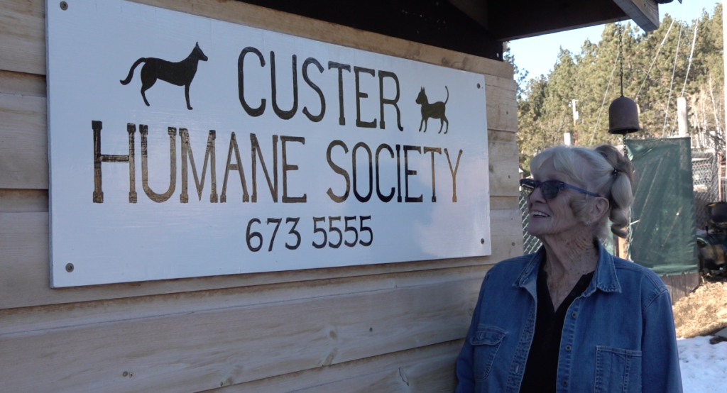 Geney Ziolkowski with Custer Humane Society Sign