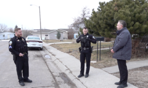 Sturgis Police Officers Dylan Goetsch and Chris Schmoker with Jason McKee