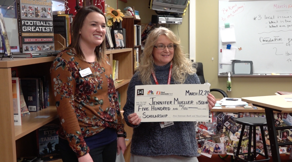 Jennifer Mueller and Kelsey York with One Plus One Check
