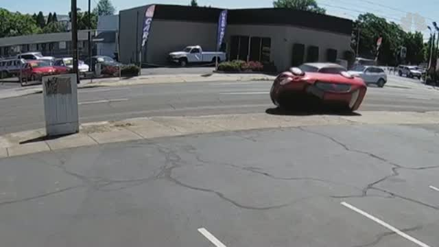 Caught On Camera: Car Flips Onto Sidewalk