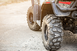 Close Up Tail View Of Atv Quad Bike. Dirty Whell Of Awd All Terrain Vehicle. Travel And Adventure Concept.copyspace.toned