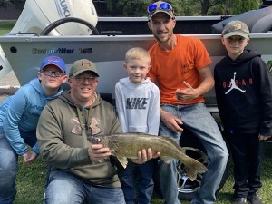 Logan Wilson In The Middle With His Winning Walleye